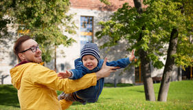 Father with son playing and having fun outdoors Stock Images