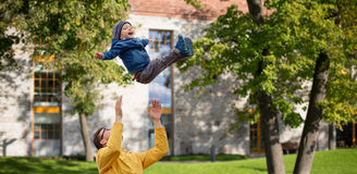 Father with son playing and having fun outdoors Stock Photography