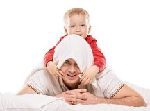 Father and Son Playing. Father playing with son at home with towel. on white background Royalty Free Stock Images