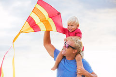 Father and son playing with kite Royalty Free Stock Image