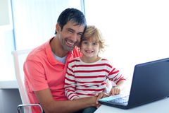 Father and son playing with a laptop Royalty Free Stock Photography