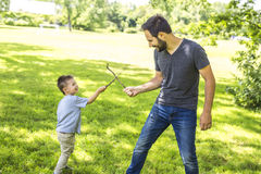 Father and son playing on the meadow. Royalty Free Stock Image
