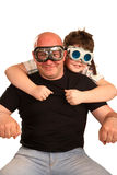 Father and son playing in motorcyclists Stock Photos