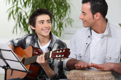 Father and son playing music Royalty Free Stock Photography