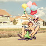 Father and son playing near a house Stock Photo
