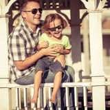Father and son playing near the house at the day time. Stock Photos