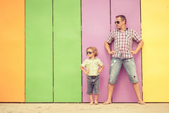 Father and son playing near the house at the day time. They standing near are the colorful wall. Concept of friendly family Stock Image