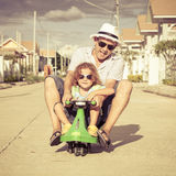 Father and son playing near a house Stock Images