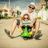 Father and son playing near a house Royalty Free Stock Photo