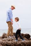 Father and son playing outdoor on beach summer Stock Images