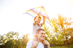 Father with son playing outdoors Stock Photos