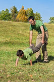Father and son playing outside. Little boy and his  father playing outside Royalty Free Stock Image
