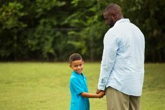 Father and son playing outside. Portrait of father and son playing outside Stock Photography