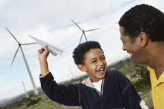 Father And Son Playing With Paper Plane Royalty Free Stock Photos