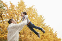 Father And Son Playing a Park in Autumn Royalty Free Stock Photography