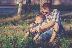 Father and son playing in the park at the day time. Concept of friendly family Royalty Free Stock Photo