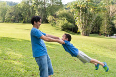 Father and son playing in the park Royalty Free Stock Photos