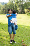 Father and son playing in the park Stock Photos