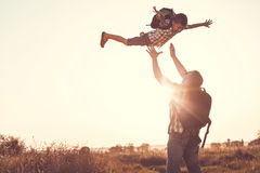 Father and son playing in the park at the sunset time. Royalty Free Stock Photos
