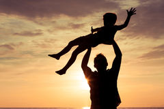 Father and son playing in the park at the sunset time. Stock Image