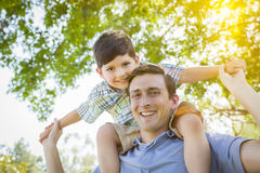 Father and Son Playing Piggyback in the Park Royalty Free Stock Images