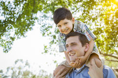 Father and Son Playing Piggyback in the Park Royalty Free Stock Photography