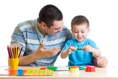 Father and son playing with plasticine Stock Photo