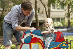 Father and son playing at playground Stock Photo