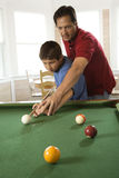 Father and Son Playing Pool Stock Photos
