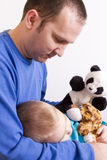 Father and son playing with puppets Stock Photography
