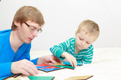 Father and son playing with puzzle Royalty Free Stock Images