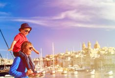 Father and son playing on the quay of Malta Royalty Free Stock Images