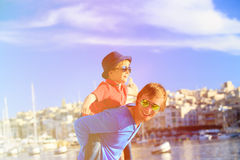 Father and son playing on the quay of Valetta Stock Image