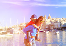 Father and son playing on the quay of Valetta Royalty Free Stock Image