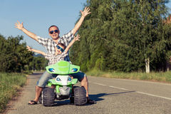 Father and son playing on the road at the day time. Royalty Free Stock Photos