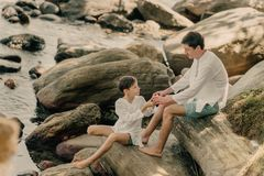 Father and son are playing on rocks. Near the ocean Royalty Free Stock Photos