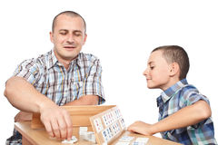 Father and son playing rummy Stock Photo