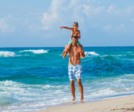 Father and son playing in the sea. Father and his son playing in wave in the sea. Concept of friendly family Stock Images