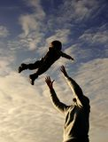 Father and son playing on sky background Royalty Free Stock Images