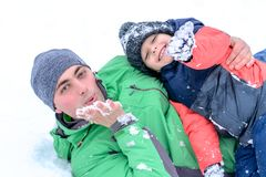 Father and son playing in the snow. Father and son play in the snow, positive emotions Royalty Free Stock Photography
