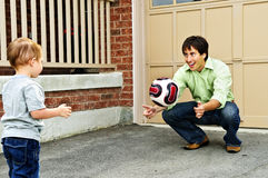 Father and son playing soccer stock photos