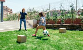 Father and son playing soccer. In the garden stock photography