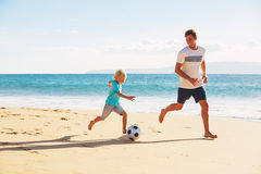 Father and Son Playing Soccer Royalty Free Stock Image