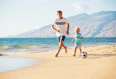 Father and Son Playing Soccer Stock Image
