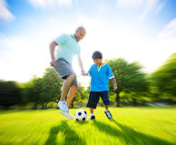 Father Son Playing Soccer Park Summer Concept Royalty Free Stock Image