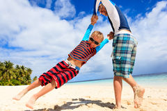 Father and son playing on summer beach Royalty Free Stock Images