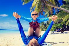 Father and son playing on summer beach Stock Images