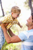 Father And Son Playing In Summer Garden. Having Fun Royalty Free Stock Photo