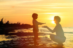 Father and son playing at sunset Royalty Free Stock Images