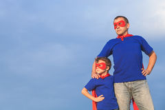 Father and son playing superhero at the day time. People having fun outdoors. Concept of friendly family Stock Photo